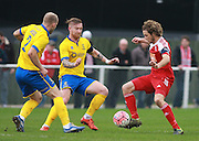 Whitehawk midfielder Sergio Torres takes on Lincoln City midfielder Alan Power & Lincoln City defender Bradley Wood during the The FA Cup match between Whitehawk FC and Lincoln City at the Enclosed Ground, Whitehawk, United Kingdom on 8 November 2015. Photo by Bennett Dean.