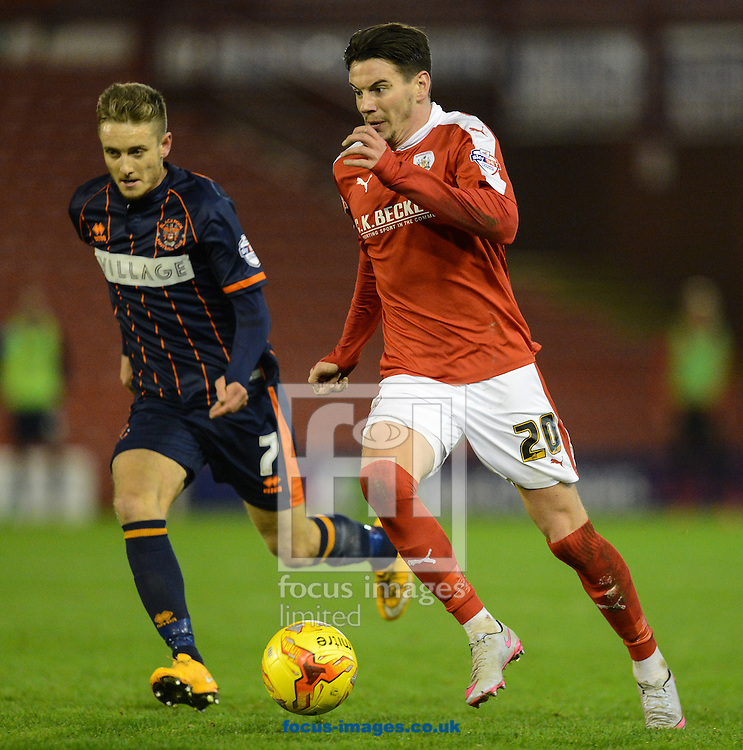 Adam Hammill of Barnsley and Jarrett Rivers of Blackpool during the Sky Bet League 1 match at Oakwell, Barnsley<br /> Picture by Richard Land/Focus Images Ltd +44 7713 507003<br /> 28/12/2015