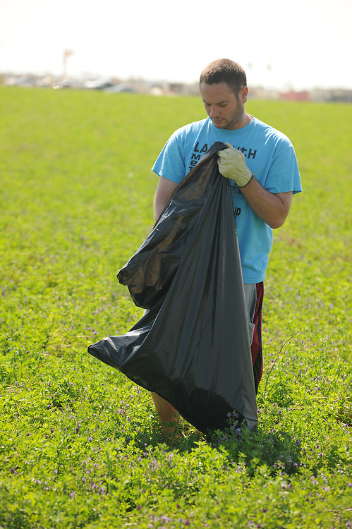 Methodist Youth from various communities across Oklahoma helped clean farmers fields near the city of El Reno.  Debris left in wheat, alfalfa, and other farm land was removed to allow the crops to be harvested.