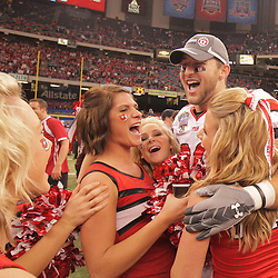 2 January 2009: Utah linebacker Mike Wright (20) celebrates with Utah cheerleaders following a 31-17 win by the Utah Utes over the Alabama Crimson Tide in the 75th annual Allstate Sugar Bowl at the Louisiana Superdome in New Orleans, LA.