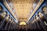 """The Papal Basilica of St Paul Outside the Walls """"Basilica Papale di San Paolo fuori le Mura"""" is one of four churches that are the great ancient major basilicas or papal basilicas of Rome.  The basilica was founded by the Roman Emperor Constantine I over the burial place of Saint Paul, where it was said that, after the Apostle's execution, his followers erected a memorial, called a cella memoriae. After a fire in 1823 this mosaic facade of the Basilica was the only piece of architecture to survive.  The Basilica was re-created in exact replica in 1840."""