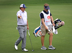 May 4, 2019 - Charlotte, NC, USA - Jason Dufner, left, talks with his caddie as they approach the 9th green at Quail Hollow Club in Charlotte, N.C., during third-round action of the Wells Fargo Championship on Saturday, May 4, 2019. (Credit Image: © TNS via ZUMA Wire)