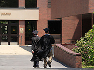 Middletown, NY - Two graduates walk toward an academic building after the 58th commencement at Orange County Community College on May 17, 2008.