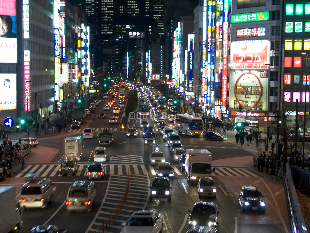 a major crossroad through the city at night Tokyo