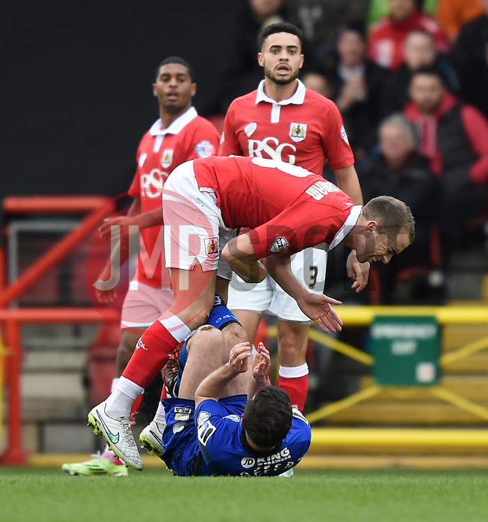 Bristol City captain Aaron Wilbraham succumbs to the boot of a Rochdale player - Photo mandatory by-line: Paul Knight/JMP - Mobile: 07966 386802 - 28/02/2015 - SPORT - Football - Bristol - Ashton Gate Stadium - Bristol City v Rochdale - Sky Bet League One