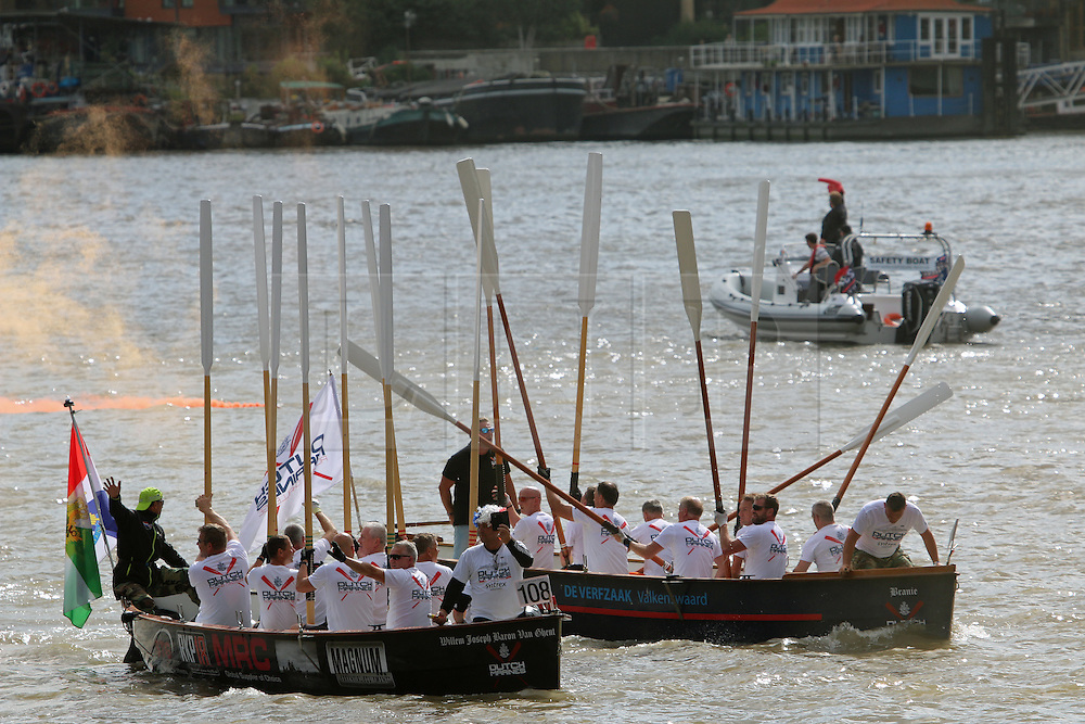© Licensed to London News Pictures. 12/09/2015. Dutch marines taking part in the Dutch Marines Rowing Challenge from the Netherlands to London celebrated after finishing their challenge while also taking part in the Great River Race. Hundreds of traditional craft have taken to the Thames for the annual Great River Race. The 21 mile rowing race fom Millwall to Richmond is known as London's river marathon. Credit : Rob Powell/LNP