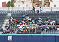 Tennis - 2019 Queen's Club Fever-Tree Championships - Day Two, Tuesday<br /> <br />  A few hardy soles sit under umbrellas as rain delays the start of todays proceedings at The Queens Club.<br />  <br /> COLORSPORT/DANIEL BEARHAM
