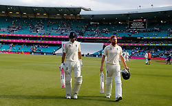 England's Joe Root and Dawid Malan walk off at stumps during day four of the Ashes Test match at Sydney Cricket Ground.