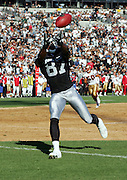 OAKLAND, CA - AUGUST 20:  Wide receiver Alvis Whitted #87 of the Oakland Raiders reaches to catch a pass against the San Francisco 49ers at McAfee Coliseum on August 20, 2006 in Oakland, California. The Raiders defeated the Niners 23-7. ©Paul Anthony Spinelli *** Local Caption *** Alvis Whitted