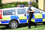 Northamptonshire Police raid a house on Polwell lane in Barton seagrave, near Kettering, following a tip that a person involved in a shooting the previous day was hiding there.