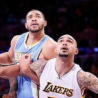 23 November 2014: Denver Nuggets center JaVale McGee (34) vies for the rebound with Los Angeles Lakers center Robert Sacre (50) during the Los Angeles Lakers season game versus the Denver Nuggets, at the Staples Center, Los Angeles, California, USA.