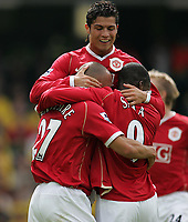 Photo: Lee Earle.<br /> Watford v Manchester United. The Barclays Premiership. 26/08/2006. United's Mikael Sivestre (L) is congratulated by Cristiano Ronaldo (b) and Luis Saha (r).