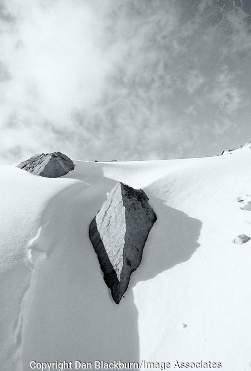 Boulders Buried in Snow in Humphreys Basin Below Mt. Humphreys in the Sierra Nevada of California