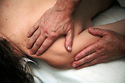 Massage of scapula and shoulder area during Swedish massage