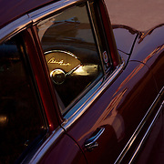 The last rays of sunshine fall on the interior of a 1956 Chevy BelAir as it sits in front of a diner in Pleasant Hill, Iowa, a suburb of Des Moines...  The cars and their owners were in Des Moines over the 4th of July weekend for the Good Guys 16th Heartland Nationals held at the Iowa State Fairgrounds, bringing over 3,500 of the country?s hottest rods and coolest customs to Iowa?s Capital City. ..Exhibitors are very skilled, multi-talented craftsmen. They dedicate thousands of hours to bring their hot rod or custom  autos to a high standard. Unlike many car shows the Good Guys usually drive both to and from the event...Photo by David Peterson..
