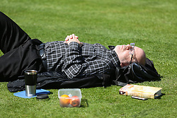 © Licensed to London News Pictures. 04/05/2016. Leeds, UK. A city worker enjoys the bright warm sunshine during their lunch breaks in Leeds, West Yorkshire. Britain is experience warmer weather this week with temperatures to rise to 23 degrees celsius this weekend. Photo credit : Ian Hinchliffe/LNP
