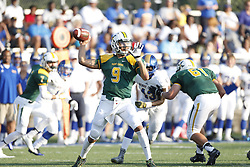 St. X quarterback Desmond Ridder rolls out of the pocket to look for an open receiver in the first quarter. Henry Clay hosted St. Xavier at Lexington Catholic High School, Friday, Aug. 28, 2015 in Lexington.
