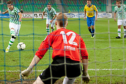 Boban Jovic #5 of Olimpija and Matic Kotnik #12 of Celje during football match between NK Olimpija and NK Celje in 6th Round of Prva liga NZS 2012/13, on August 18, 2012 in SRC Stozice, Slovenia. (Photo by Urban Urbanc / Sportida.com)