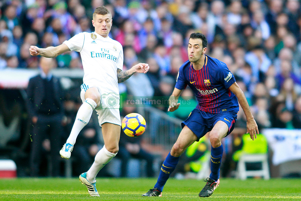 Real Madrid's Toni Kroos (l) and FC Barcelona's Sergio Busquets during La Liga match. Madrid, Spain, on December 23, 2017. Photo by Acero/AlterPhotos/ABACAPRESS.COM
