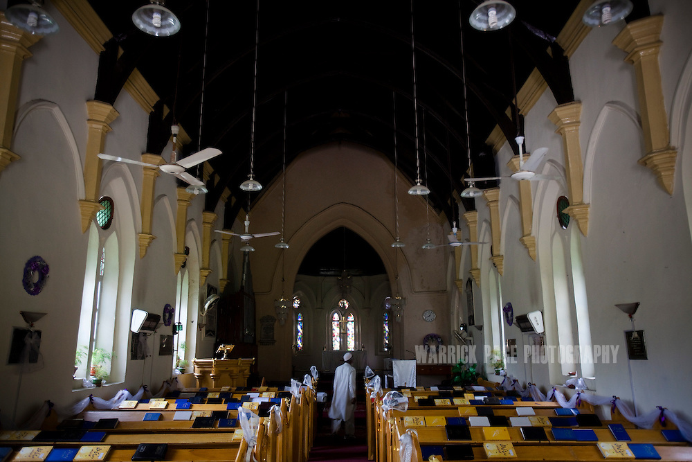 A caretaker walks down the aisle of St. Luke's Church, on May 9, 2011 in Abbottabad, Pakistan. The town of Abbottabad became infamous after the US launched a midnight raid on a compound housing Osama bin Laden in the garrison town, on May 2, 2011. The operation, code-named Operation Neptune Spear, was launched from neighbouring Afghanistan and resulted in the killing of one of the world's most notorious terrorists and who claimed responsibility for the 9/11 attacks in the US. U.S. forces took bin Laden's body to Afghanistan for identification, then dumped it the Arabian Sea. Pakistan has since been widely suspected as having prior knowledge of his whereabouts as the compound was less than a kilometre from the country's biggest military academy. (Photo by Warrick Page)