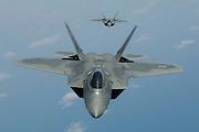 F-22As head on