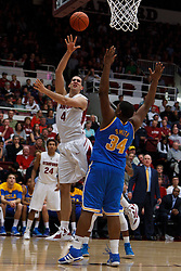 Dec 29, 2011; Stanford CA, USA;  Stanford Cardinal center Stefan Nastic (4) shoots over UCLA Bruins center Joshua Smith (34) during the first half at Maples Pavilion.  Mandatory Credit: Jason O. Watson-US PRESSWIRE