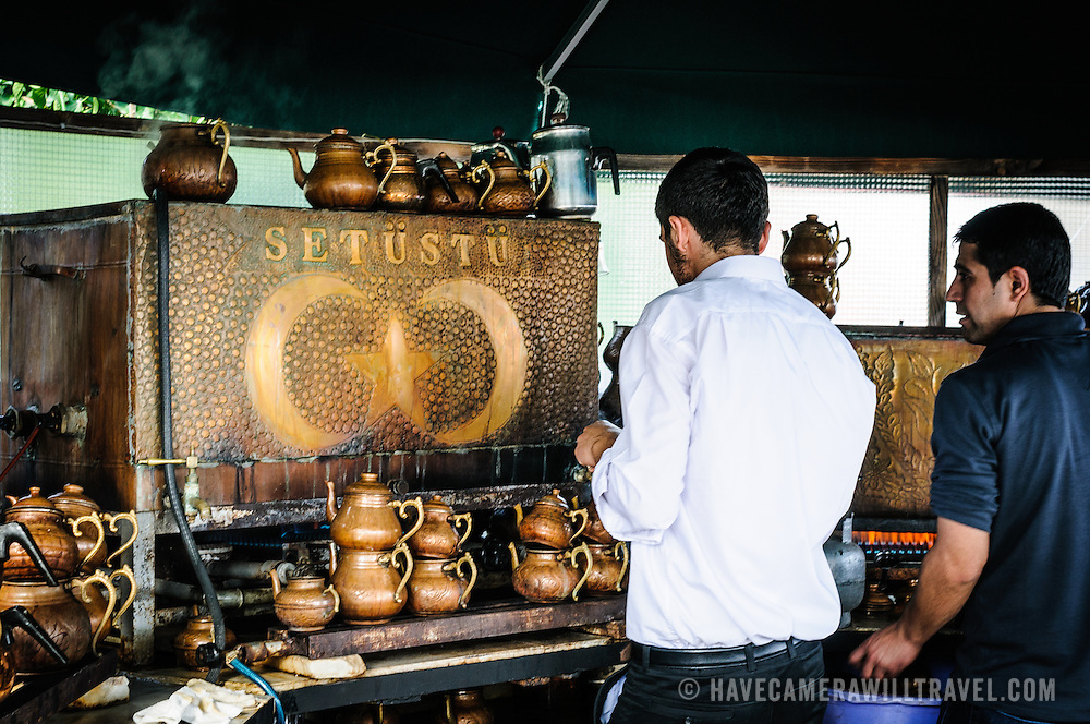 Baristas make traditional Turkish tea at a cafe near the Topkapi Palace in Istanbul.