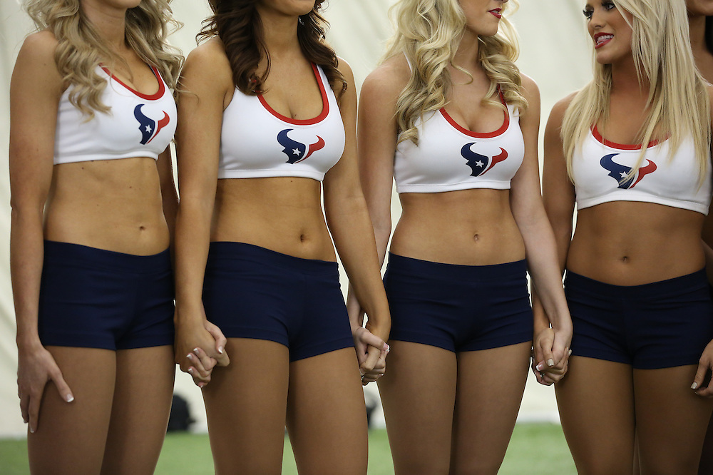 4/16/2014: Girls wait nervously and hold each others hands while waiting to hear their names being called out. Fifty girls showed up on April 16, 2014 at the Houston Texans practice facility in Houston, Texas to see which 35 girls made the 2014-2015, Houston Texans Cheerleading Team.