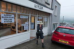 © Licensed to London News Pictures. 08/06/2017. Merthyr Tydfil, Mid Glamorgan, Wales, UK. Early voters arrive to cast their vote at the hair salon Asylum. Damp and drizzly weather in the old mining town of Merthyr Tydfil as the polling tations open at 7.00am on the day of the general election in Wales, UK. Photo credit: Graham M. Lawrence/LNP