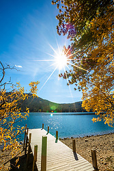 """Donner Lake in Autumn 13"" - Photograph of yellow fall foliage at a dock on Donner Lake in Truckee, California."