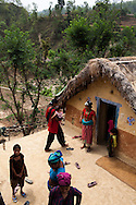 An overview of 14 year old Tulasa Khadka's family home in the remote village of Dungi Khola, near Chhinchu, Surkhet district, Western Nepal, on 1st July 2012. Tulasa eloped at 13 and gave birth to a stillborn baby weighing less than 1 kg a week ago. She walks through the hills to the nearest hospital and she went into labour while on her way there for a checkup at almost full term. In Surkhet, Save the Children partners with Safer Society, a local NGO which advocates for child rights and against child marriage. Photo by Suzanne Lee for Save The Children UK