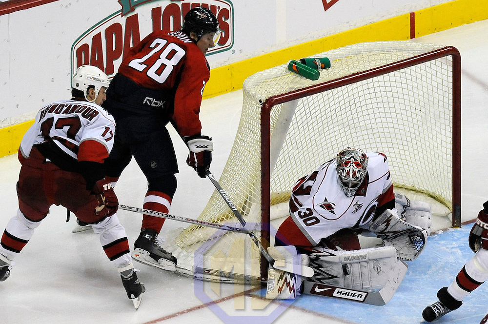 08 February 2008:  Carolina Hurricanes goalie Cam Ward (30) stops a shot in the third period taken by Washington Capitals left wing Alexander Semin (28) as center Rod Brind'Amour (17) closes in on the play at the Verizon Center in Washington, D.C.  The Hurricanes defeated the Capitals  2-1.