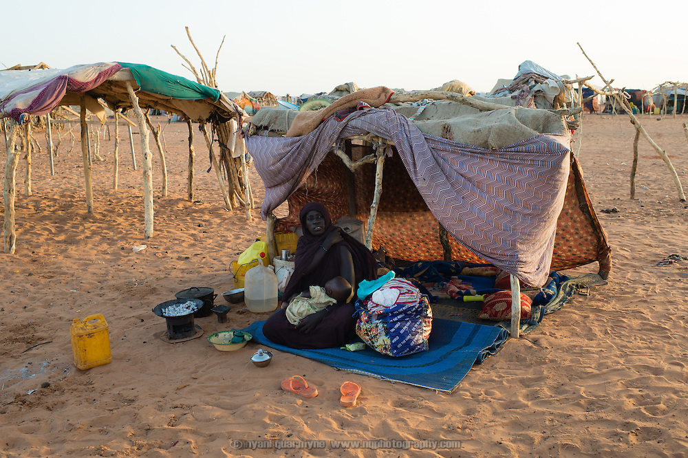 Aicha Mint Mohamed and her daughter Ajmiya Mint Mohamed at the Mbera camp for Malian refugees in Mauritania on 11 March 2013. According to Aicha, when she was registered at the camp on 9 March she was told there were no tents available, leaving her and her daughter with no alternative to this makeshift construction.