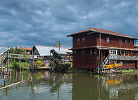 INLE LAKE, MYANMAR - CIRCA DECEMBER 2017: Typical house built on stilts in Inle Lake, Myanmar