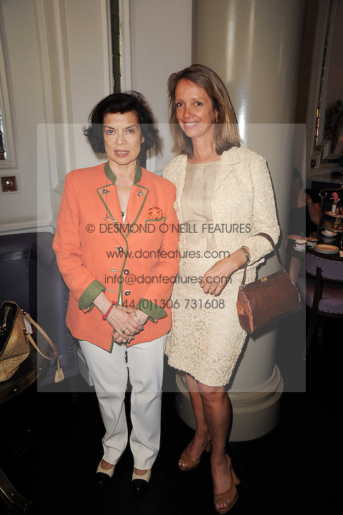 Left to right, BIANCA JAGGER and SABRINA GUINNESS at 'Amnestea' a tea party hosted my Amnesty International held at The Langham Hotel, Portland Place, London on 25th May 2010.