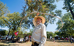 Robert Duke spins a rope around his body while performing tricks at the Brazos Valley Museum of Natural History's Boonville Days Heritage Fair on Saturday, Oct. 10, 2015 in Bryan, Texas.  (AP Photo/Sam Craft, The Bryan-College Station Eagle)