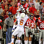 Mississippi wide receiver Donte Moncrief (12) catches a pass over Texas cornerback Quandre Diggs (6) during the first half of an NCAA college football game in Oxford, Miss., Saturday, Sept. 15, 2012. (Photo/Thomas Graning)