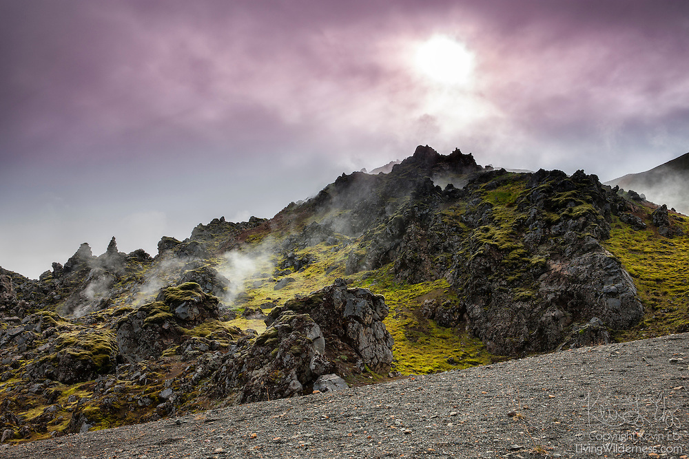 Steam rises from a volcanic cone at Landmannalaugar, located in the highlands of Iceland. Landmannalaugar, part of the Fjallabak Nature Reserve, sits at the edge of the Laugahraun lava field, which was formed in an eruption around the year 1477.