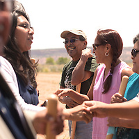 Jeff Peynetsa smiles and is congratulated by Zuni council members on the groundbreaking of a new block of homes though Zuni Housing Authority and USDA in Zuni Wednesday. Peynetsa is a maintenance worker with Zuni Housing Authority.