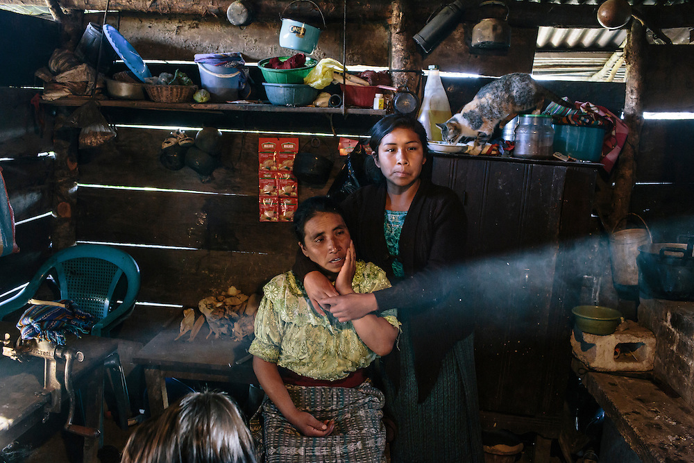 Rosa Pacheco, rests at home with her four daughters in the community of Xix, Guatemala. Pacheco, a single mother, said that aren't many opportunities in town to make a living. After her husband left her, she has had to provide for her entire family. She then started working at Parque Agro-Ecological Ixil, in Nebaj. With the money she earns from the farm, Pacheco is able to put all of her children through school. The community farm, about 640 acres, was purchased by 75 farmers and in partnership with the Nature Conservancy and USAID who have taught them best agricultural practices, like how to diversify crops, and best practices in manufacturing, such as to keep crops from human contamination. After five years, the farmers have paid off 85 percent of the loan to purchase the land, and the farmers have been able to put their children through school and receive medical care as a result of the new income.
