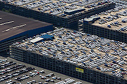 BLG automoblie logistics. Structured parking garages for cars waiting to be exported at loading docks.