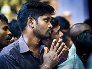"09 JULY 2017 - SINGAPORE:  A Hindu man prays in Sri Veeramakaliamman Temple in Singapore's ""Little India."" There are hundreds of thousands of guest workers from the Indian sub-continent in Singapore. Most work 5 ½ to six days per week. On Sundays, the normal day off, they come into Singapore's ""Little India"" neighborhood to eat, drink, send money home, go to doctors and dentists and socialize. Most of the workers live in dormitory style housing far from central Singapore and Sunday is the only day they have away from their job sites. Most work in blue collar fields, like construction or as laborers.   PHOTO BY JACK KURTZ"