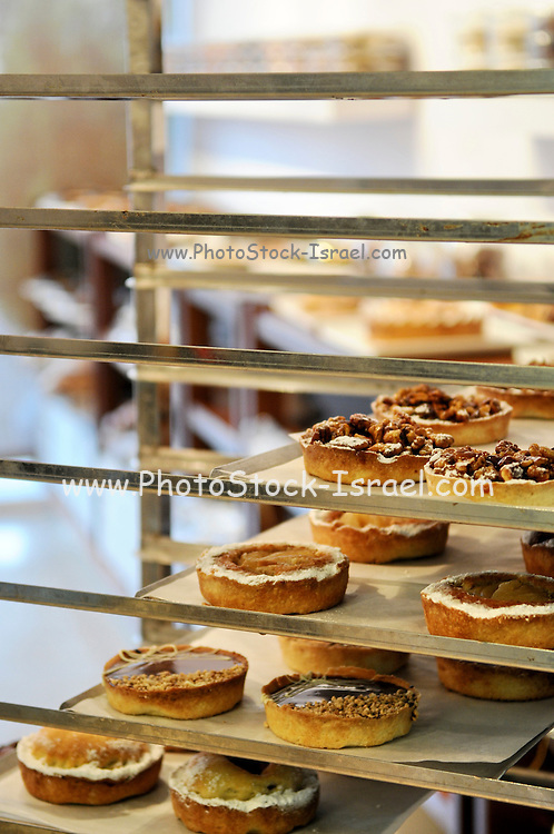 Interior of a bakery shop pies on diplay