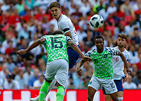 Football - 2018 International Friendly (pre-World Cup warm-up) - England vs. Nigeria<br /> <br /> John Stones (England) and Joel Obi (Nigeria) at Wembley Stadium.<br /> <br /> COLORSPORT/DANIEL BEARHAM