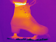 Thermogram of an ice skate.  The different colors represent different temperatures on the object. The lightest colors are the hottest temperatures, while the darker colors represent a cooler temperature.  Thermography uses special cameras that can detect light in the far-infrared range of the electromagnetic spectrum (900?14,000 nanometers or 0.9?14 µm) and creates an  image of the objects temperature..