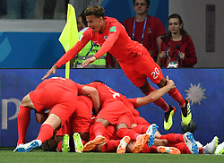 June 18, 2018 - Volgograd, Russia - DELE ALLI leaps on top of the pile as England players celebrate scoring during a Group G match against Tunisia at the 2018 FIFA World Cup. (Credit Image: © Liu Dawei/Xinhua via ZUMA Wire)