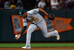 SAN FRANCISCO, CA - AUGUST 13: Marcus Semien #10 of the Oakland Athletics fields a ground ball against the San Francisco Giants during the eighth inning at Oracle Park on August 13, 2019 in San Francisco, California. The San Francisco Giants defeated the Oakland Athletics 3-2. (Photo by Jason O. Watson/Getty Images) *** Local Caption *** Marcus Semien