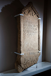 © Licensed to London News Pictures 25/01/2016, Cirencester, UK. A unique Roman tombstone, found in February 2015, goes on display for the first time at Corinium Museum in Cirencester. The tombstone was found near skeletal remains thought to belong to the person named on its inscription, making the discovery unique. After being found during excavation works on a former site of a garage, archaeologists said they believed it marked the grave of a 27-year-old woman called Bodica. Other theories point to it possibly belonging to a couple - as skeletal remains of women were found nearby.<br />