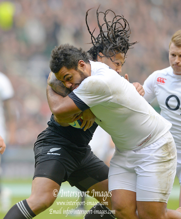 Twickenham, United Kingdom, Right, England,  Billy VUNIPOLA, is tackled by Ma'a NONU , during the 2013 QBE  Autumn Rugby International, England vs New Zealand, played  Saturday  16/11/2013 at the RFU Stadium Twickenham,<br /> England. [Mandatory Credit: Peter Spurrier/Intersport<br /> Images}