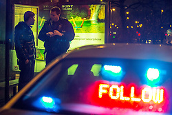 © Licensed to London News Pictures . 20 December 2013 . Manchester , UK . The Inspector stops a man who had been driving too slowly on the motorway . A Mad Friday shift with Inspector Matt Bailey-Smith , of Greater Manchester Police's ANPR and Tactical Vehicle Intercept Unit . Photo credit : Joel Goodman/LNP